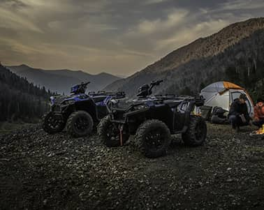 Two Polaris ATVs and a Tent