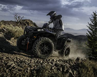 Person riding black Polaris ATV